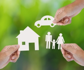 stock-photo-hand-holding-a-paper-home-car-family-on-green-background-insurance-concept-161784542
